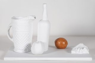 "George Segal, ""Classical Still Life"", 1990, sculpture, partially glazed porcelian multiple in white and orange, size- 12 x 20 3/4 x 13 1/2 inches, edition of 95"